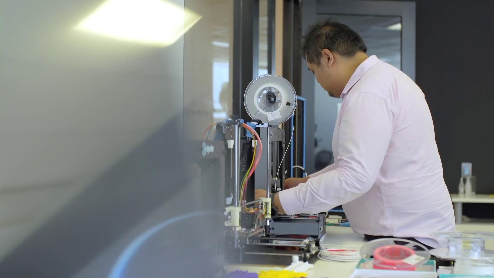 Flinders Innovation Centre's manager Raphael Garcia fine-tuning a 3D printer